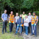 Community Payback support Hamilton Davies Trust to revive Irlam Linear Park by cutting back some of the overgrown pathway and entrance.